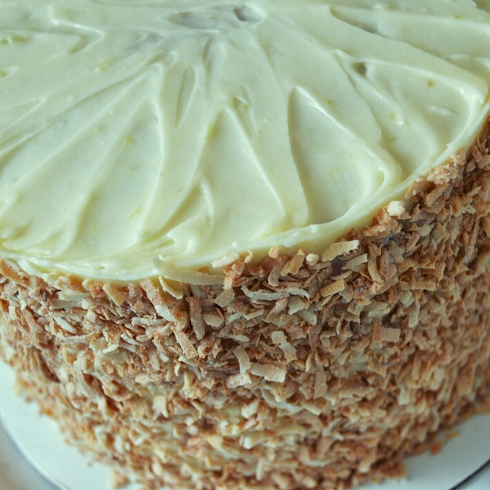 This Coconut Sponge Cake Is A Moist Coconut Flavored Buttered Cake Filled With Homemade Lemon Curd And Frosted With A Coconut Rum Frosting